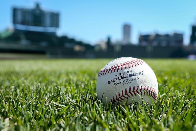 CHICAGO, ILLINOIS - APRIL 16: A baseball sits on the field before the game between the Colorado Rockies and Chicago Cubs at Wrigley Field on April 16, 2016 in Chicago, Illinois
