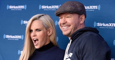 Jenny McCarthy and Donnie Wahlberg attend during Jenny McCarthy's SiriusXM show from Grant Park in Chicago, IL before the NFL Draft on April 28, 2016 in Chicago, Illinois.