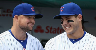 Jon Lester #34 (L) and Anthony Rizzo #44 of the Chicago Cubs