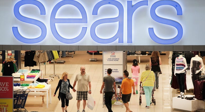 Customers shop at a Sears store in Woodfield Mall on July 20, 2017 in Schaumburg, Illinois.