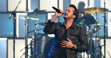 Luke Bryan performs onstage at the 51st annual CMA Awards at the Bridgestone Arena on November 8, 2017 in Nashville, Tennessee. (