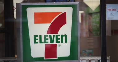 A sign hangs outside of a 7-Eleven store on January 10, 2018 in Chicago, Illinois.