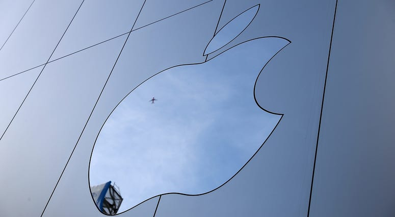The Apple logo is displayed on the exterior of an Apple Store on February 1, 2018 in San Francisco, California.