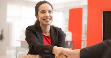 Latin Businesswoman Shaking Hands with Partner