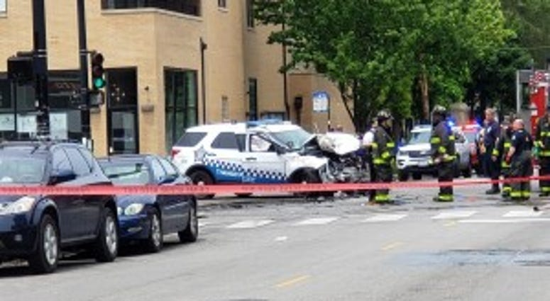 Emergency crews at the scene of a crash where a police vehicle slammed into a truck about 12:30 p.m. at the intersection of Chicago and California Avenues.