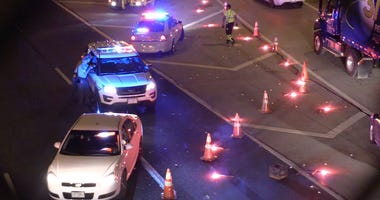 Illinois State Police investigate a stretch of the I-290 Expressway near Western Avenue for evidence of a shooting that left a person wounded, Tuesday evening.