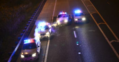 Police investigate a shooting about 4:30 a.m. Saturday, October 13, 2018 in the southbound lanes of I-57 at 159th Street in Markham.