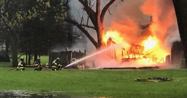 An off-duty Lisle-Woodridge firefighter rescued three people Wednesday from a burning home in west suburban Lisle.