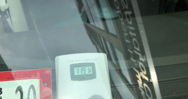 A thermometer placed in a car parked in the sun outside the hospital in the Streeterville neighborhood quickly went to 119 degrees - that was 20 degrees hotter than the air temperature at the time.