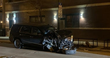 A Cadillac Escalade after crashing into seven parked vehicles April 16, 2020, in the 3000 block of North Kimball Avenue.