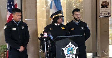 Two young Chicago police officers are being recognized for their actions at the scene of a fiery, roll-over crash with a child trapped inside.