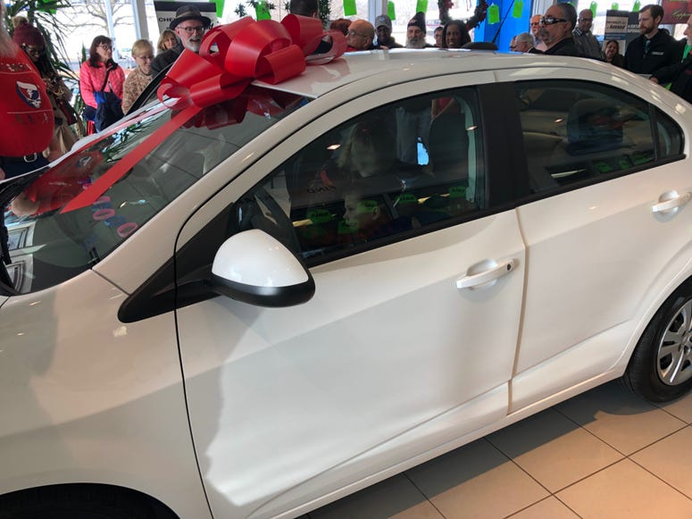 A family of five from Crete won a Chevy Sonic after submitting an essay on why winning a car would change their lives.