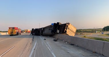 A semitrailer hangs over a retaining wall following a crash June 17, 2020, in the 9000 block of I-94.