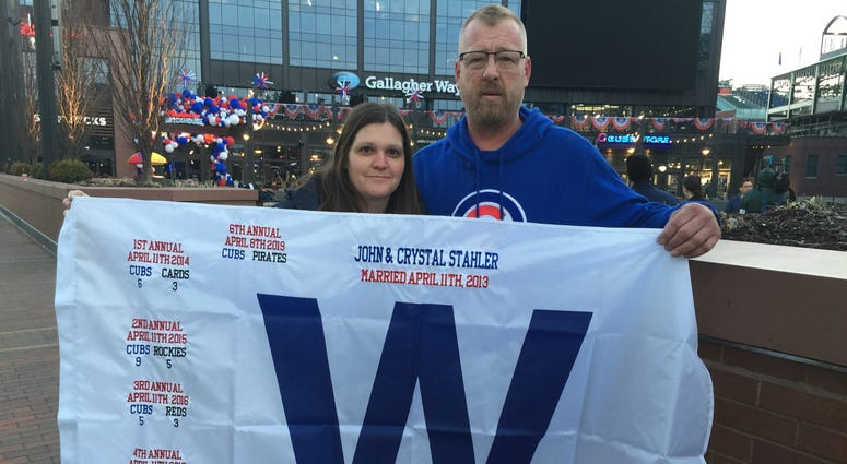 """John and Crystal Stahler with special """"W"""" flags"""