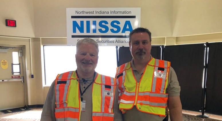 Steve Scheckel (right) and volunteer Patrick Murray