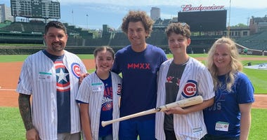 A Park Ridge cancer survivor and young baseball star spent the morning at Wrigley Field hanging out with his favorite player.