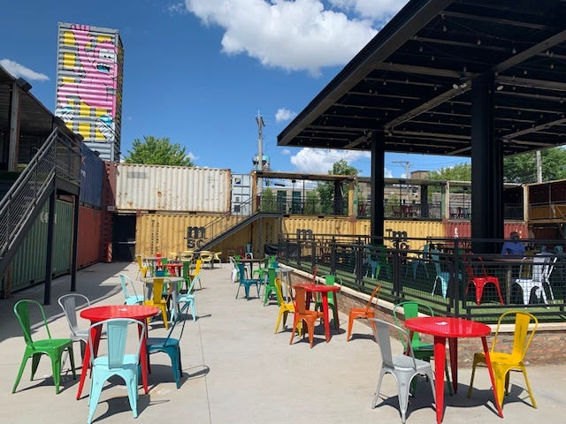 Chicago artist and muralist Mosher spent nine days a top a boom lift creating a giant, colorful mural that welcomes patrons to Recess, Fulton Market's largest outdoor patio.