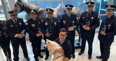 Six Chicago Police officers were honored for their quick thinking after a Chicago man jumped into the icy waters of Lake Michigan to save his dog.