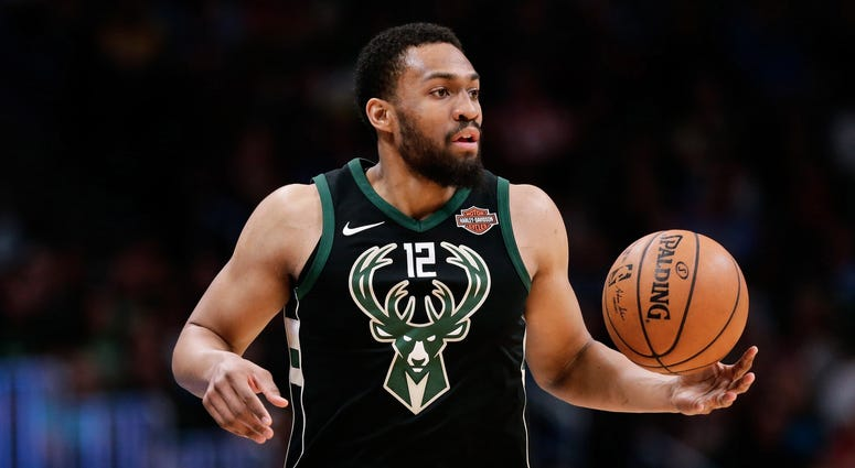 Apr 1, 2018; Denver, CO, USA; Milwaukee Bucks forward Jabari Parker (12) controls the ball in the fourth quarter against the Denver Nuggets at the Pepsi Center.