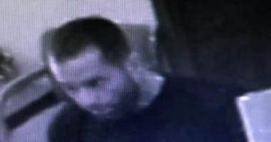 Surveillance image of the man who robbed a bank Monday morning in Joliet.