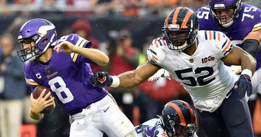 Vikings quarterback Kirk Cousins (8) is forced out of the pocket by Bears outside linebacker Khalil Mack (52).
