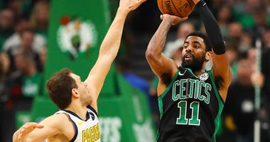 Kyrie Irving of the Boston Celtics shoots over the Indiana Pacers' Bojan Bogdanovich in the first round of the NBA playoffs.