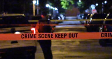 Police investigate a shooting about 10 p.m. Friday, June 8, 2018 in the 7900 block of Muskegeon Avenue in Chicago.