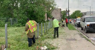 In the city's Austin neighborhood, community residents and others joined with Chicago police on Wednesday to make the area better looking than it did Tuesday.