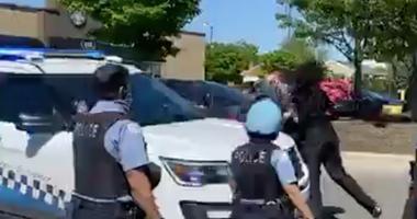 Woman Strikes Cop