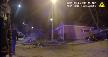 Still from a Chicago police body camera video showing the aftermath of the March 3 crash that killed 2-year-old Danyla Owens at 107th Street and Calumet Avenue.