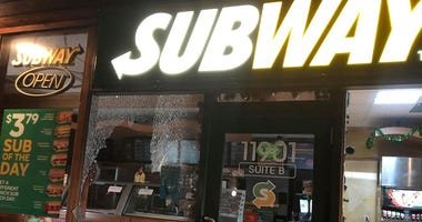 Police are looking for two people who stole a cash register from a Subway restaurant Sunday in the southwest suburb.