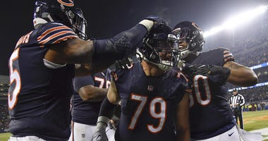 Dec 9, 2018; Chicago, IL, USA; Chicago Bears offensive tackle Bradley Sowell (79) celebrates with teammates after scoring a touchdown against the Los Angeles Rams at Soldier Field. Mandatory Credit: Quinn Harris-USA TODAY Sports