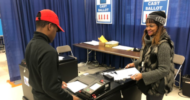 Forty-fiveseniors from Pritzker College Prep stepped out of the classroom and into the voting booth Wednesday at the new Loop Early Voting Super Site.