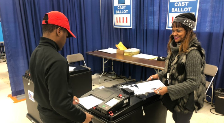 Forty-five seniors from Pritzker College Prep stepped out of the classroom and into the voting booth Wednesday at the new Loop Early Voting Super Site.