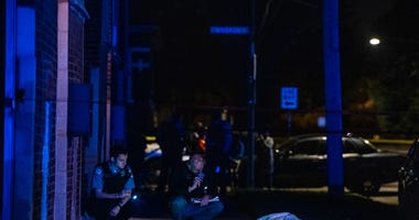 Chicago police investigate the scene where a man was shot and killed Sept. 23, 2019, in the Park Manor neighborhood.