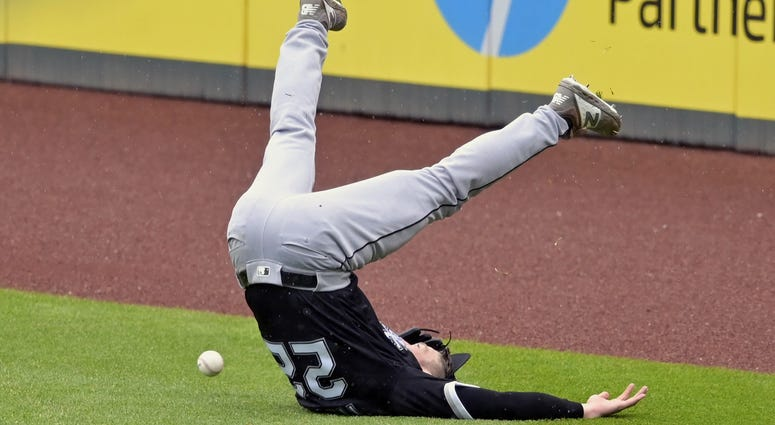 May 9, 2019; Cleveland, OH, USA; Chicago White Sox right fielder Charlie Tilson (22) loses his balance while reaching for a double by Cleveland Indians shortstop Francisco Lindor (not pictured) in the fifth inning at Progressive Field.