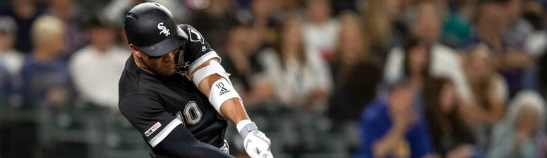Chicago White Sox's Yoan Moncada hits an RBI triple off of Seattle Mariners starting pitcher Yusei Kikuchi during the third inning of a baseball game Friday, Sept. 13, 2019, in Seattle.