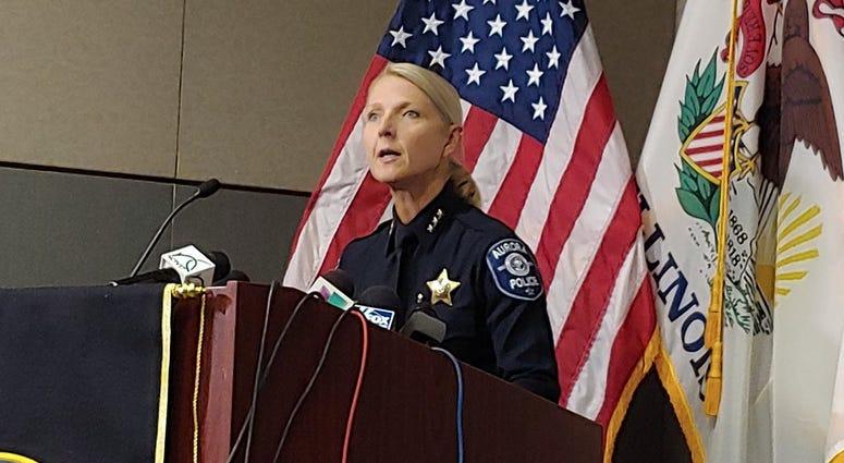 Aurora police speaking at presser