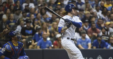 Milwaukee Brewers left fielder Ben Gamel (16) drives in two runs with a base hit in the eighth inning as Chicago Cubs catcher Willson Contreras (40) watches at Miller Park.Milwaukee Brewers left fielder Ben Gamel (16) drives in two runs with a base hit in