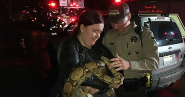 A woman in Bourbonnais is praising Kankakee County sheriff's deputies for rescuing her five-foot-long boa constrictor from her burning home this morning.