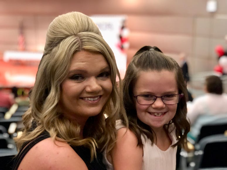Karen Cook and her daughter Braylynn attend the DCFS scholarship ceremony Friday, July 27, at the Thompson Center.