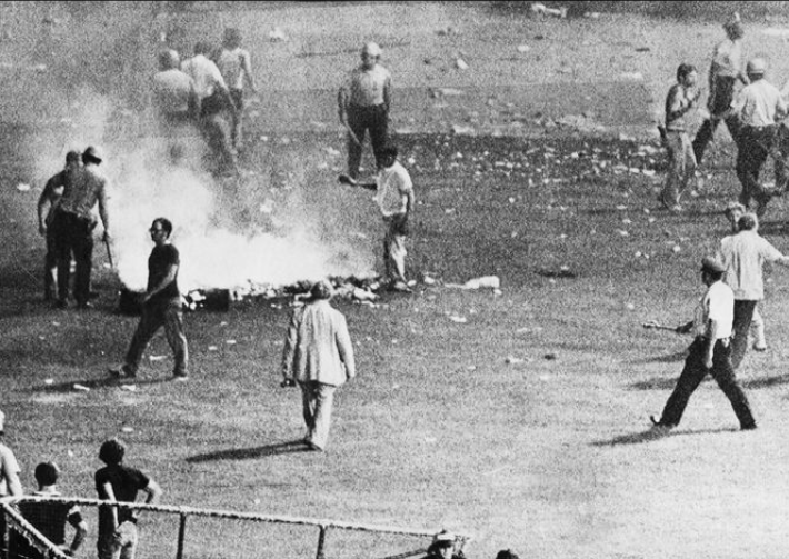 Chicago police disperse the crowd in center field at Comiskey Park after hundreds of disco records were blown up.