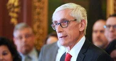 Wisconsin Gov. Tony Evers holds a news conference in Madison, Wis.