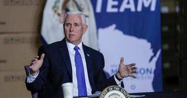 Vice President Mike Pence visits the GE Healthcare manufacturing facility Tuesday, April 21, 2020, in Madison, Wis.