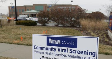 A sign is posted outside of Witham Health Services drive-through Community Viral Screening center, Monday, March 16, 2020, in Whitestown, Ind.