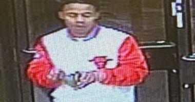 Man wanted for West Town robbery