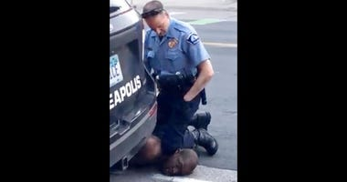 In this Monday, May 25, 2020, file frame from video provided by Darnella Frazier, a Minneapolis officer kneels on the neck of George Floyd, a handcuffed man who was pleading that he could not breathe, in Minneapolis.