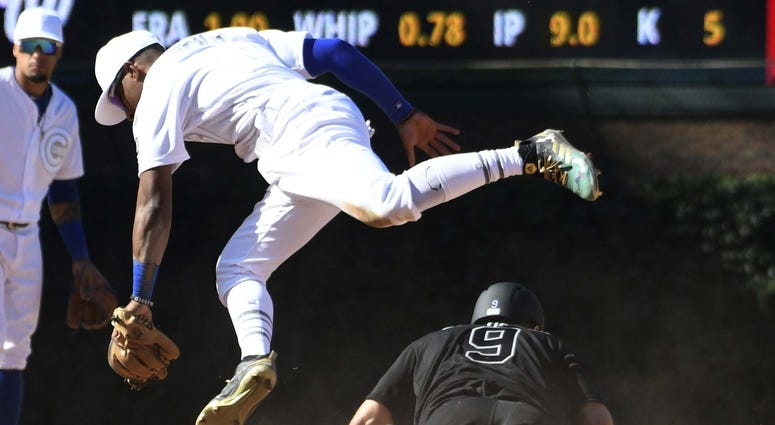 Chicago Cubs second baseman Tony Kemp (21) jumps out of the way after tagging out Washington Nationals second baseman Brian Dozier (9) on a steal attempt of second base.