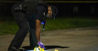 Chicago police investigate the scene where a woman who was shot Thursday night in the 8400 block of South Green. | Tyler LaRiviere/Sun-Times