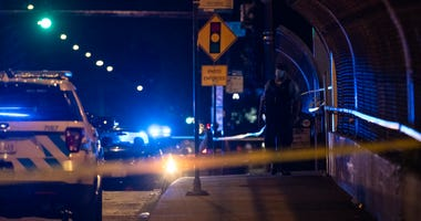 Chicago police investigate the scene where 3 people were shot in the 7900 block of South Wabash, in the Chatham neighborhood, Tuesday, July 14, 2020.